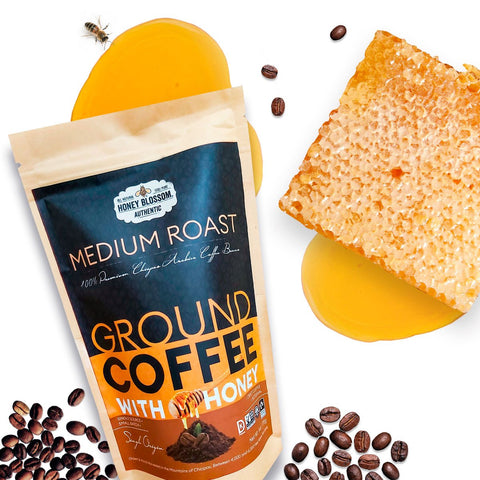 Product photo of Honey Blossom Ground Coffee with honey with a honeycomb with honey falling and coffee beans