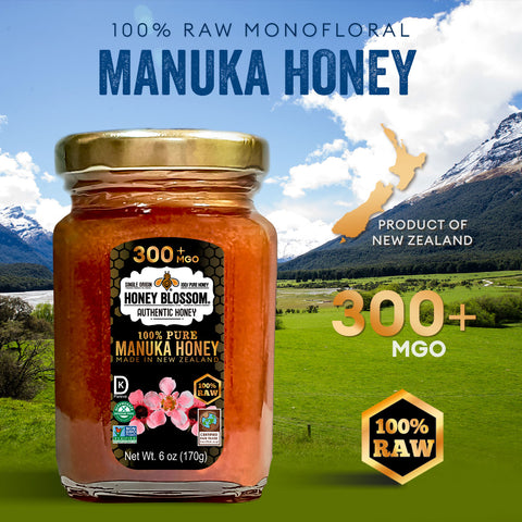 """Image of manuka jar with a landscape full of mountains with snow, ground full of grass and a lake. with text referring to: """"100% RAW Monofloral Manuka Honey. Product of New Zealand. 300+ MGO and 100% RAW""""."""