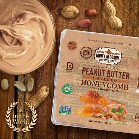 the peanut butter covered honeycomb on a wooden table with a jar of peanut butter and peanuts underneath it