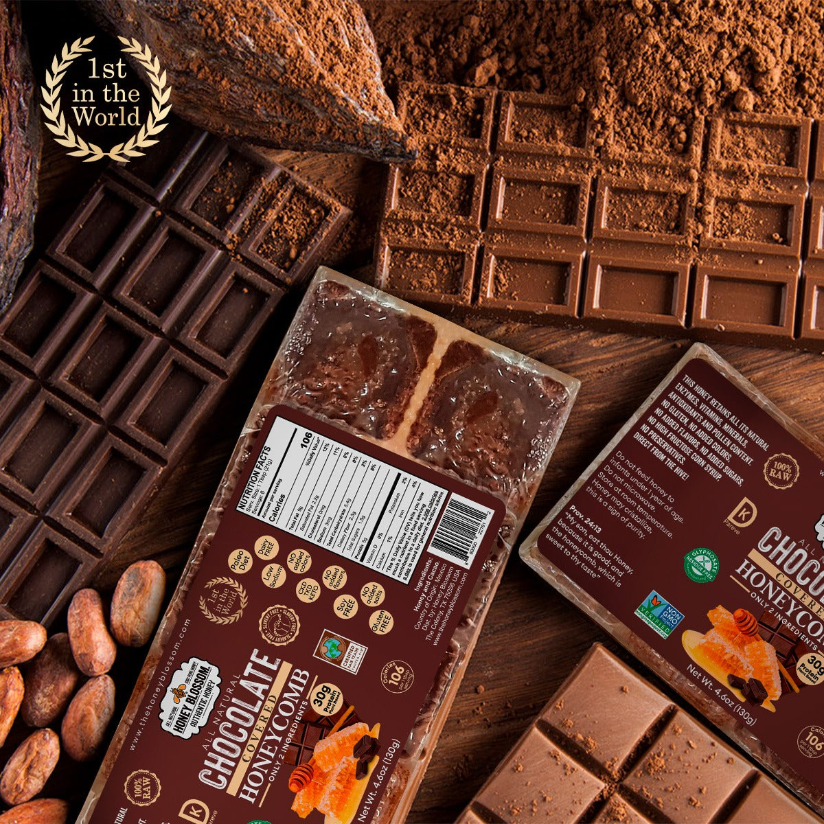 Image of 2 Chocolate Covered 100% RAW Honeycomb Snack Size, 10 Servings on a wooden table, with chocolate bars on their sides along with cacao beans and cacao powder