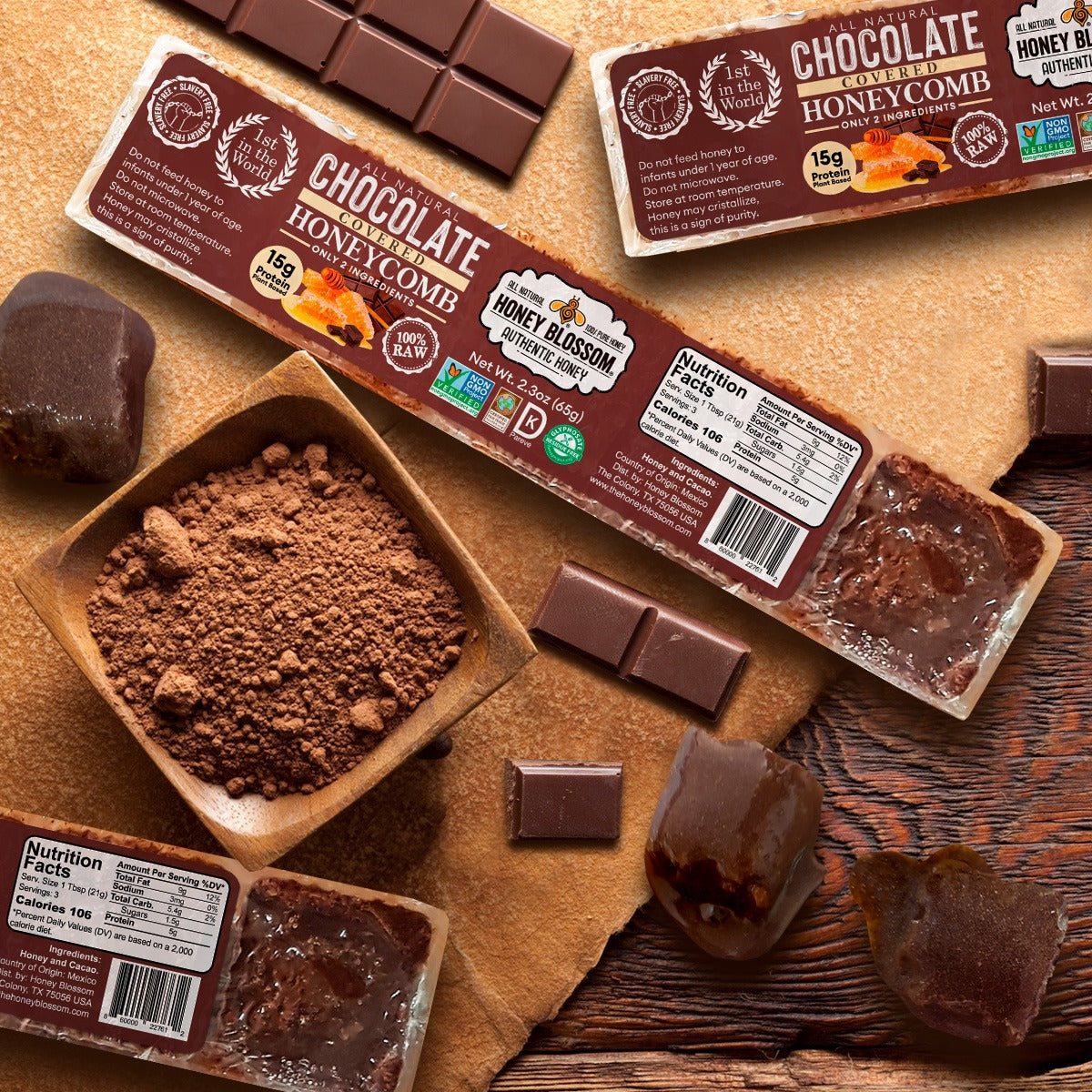Image of 2 Chocolate Covered 100% RAW Honeycomb Snack Size, 5 Servings on a wooden table, with a jar with cacao powder, chocolate bars on their sides along with cubes of honeycomb with chocolate