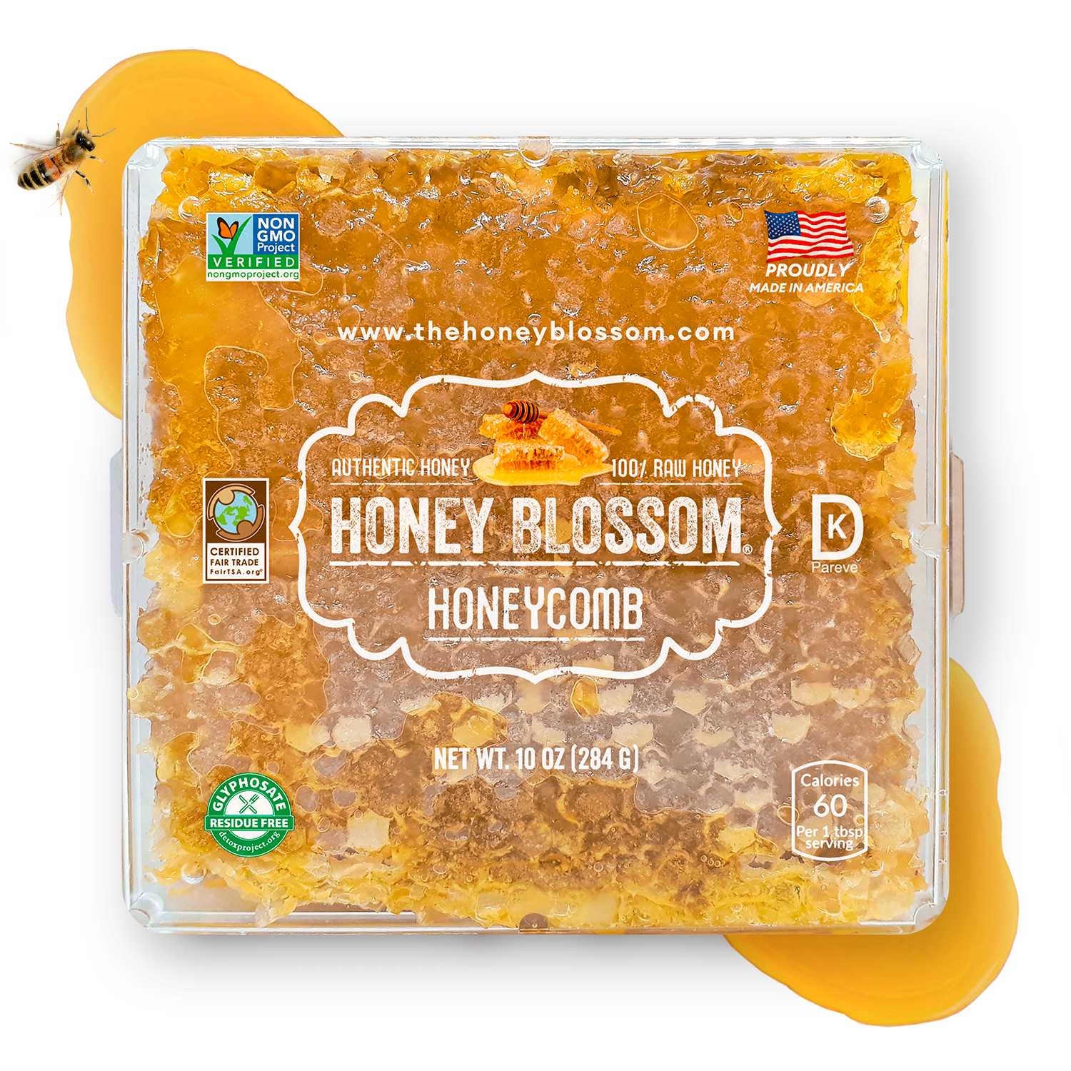 Image of Honey Blossom honeycomb on a surface, with honey spilled on its ends and a bee eating from it.