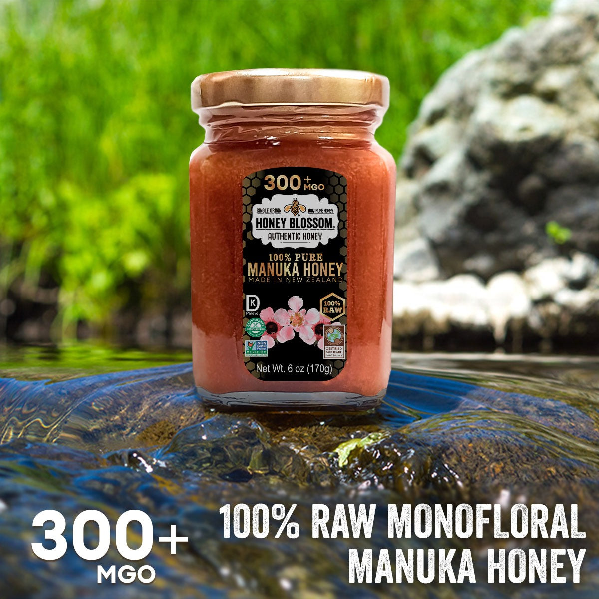 Image of a jar of Manuka Honey on a rock in a river with many trees in the background. And text that reads: 300+ MGO, 100% RAW Monofloral Manuka Honey