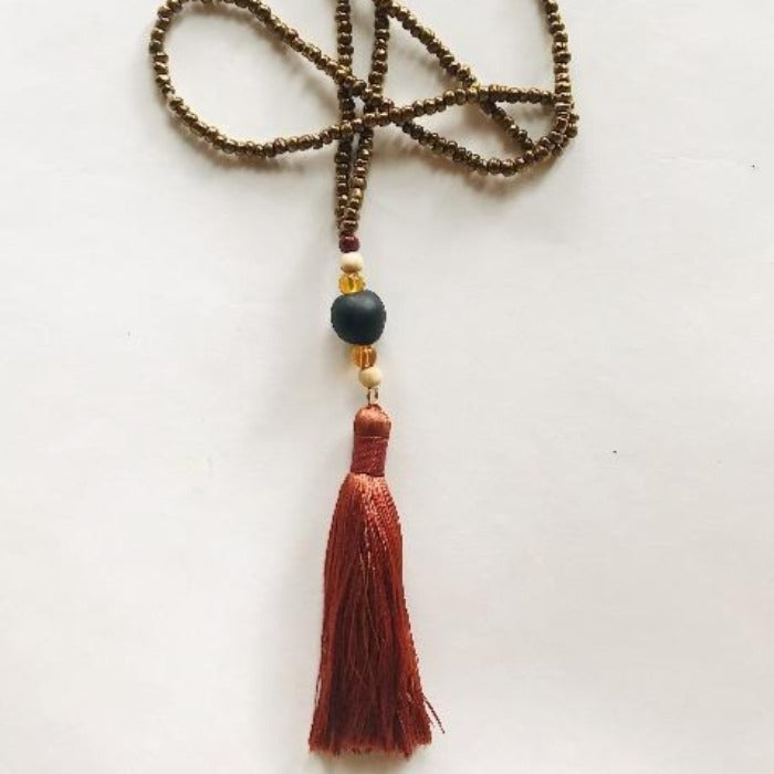 Black Ghana Glass and Burnt Orange Tassel Necklace