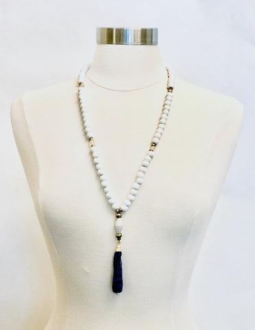 White Beaded Necklace with Blue Fabric Tassel