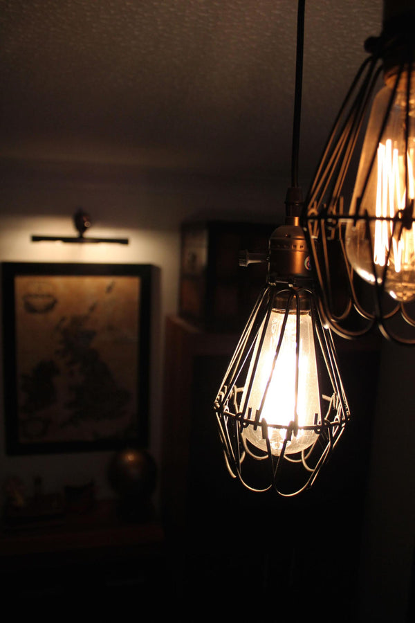 A cage light is a great nod to the industrial trend.