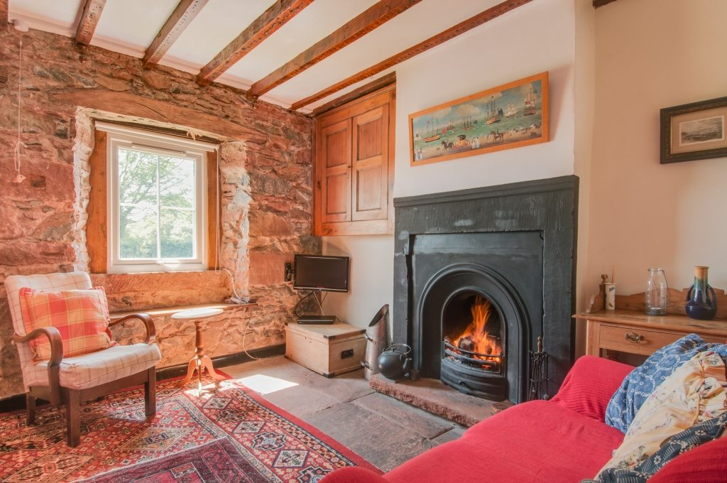 Relaxing by this roaring fire is one of our favourite things to do in the Lake District... check out the home tour of our cosy cottage. Photo credit to Stewart Smith Photography: www.stewartsmithphotography.co.uk