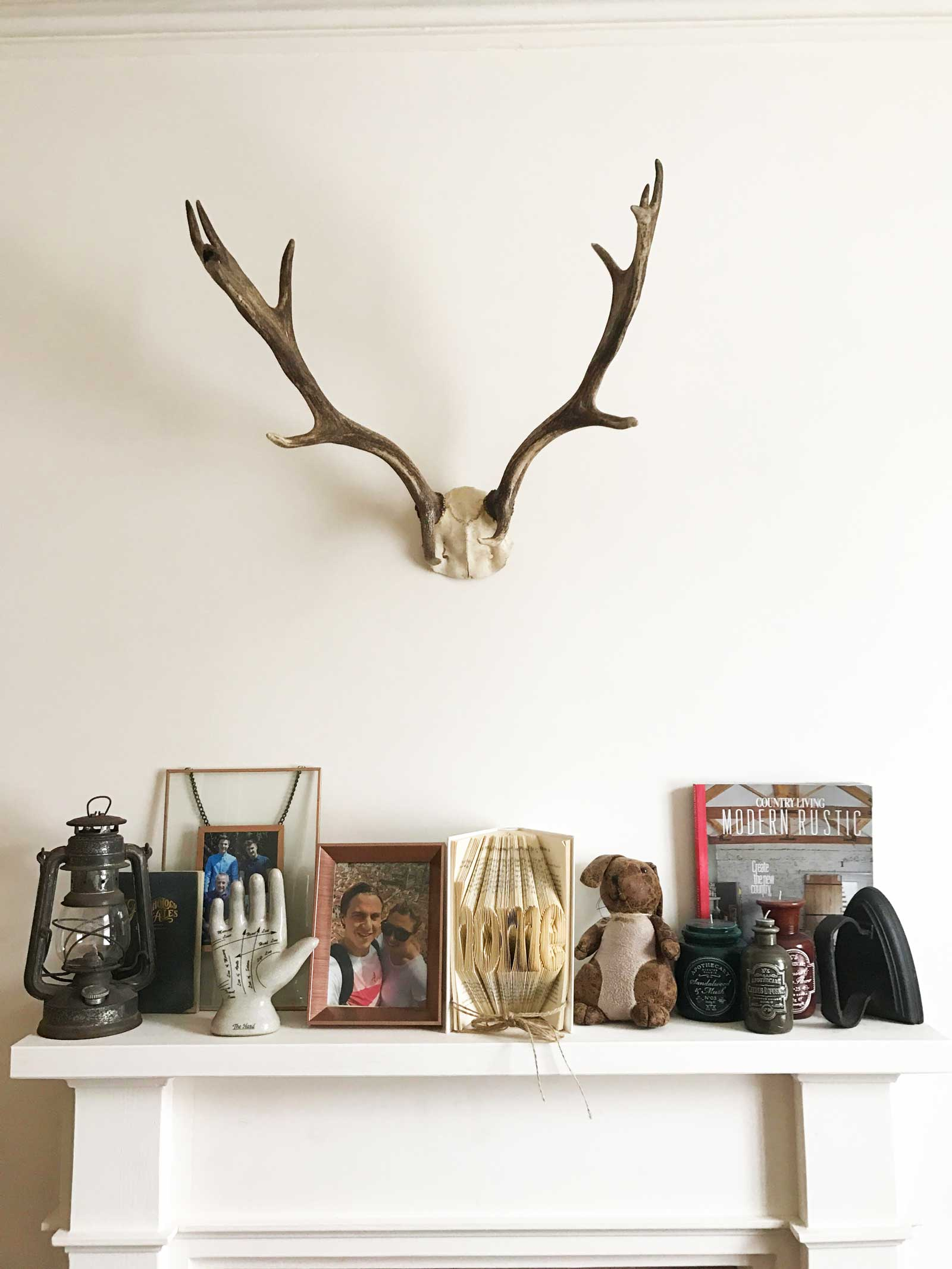 Antlers above the fireplace on www.lovetohome.co.uk