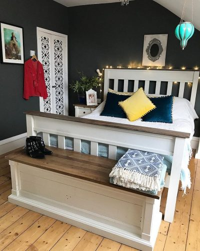 Dark bedroom walls white bed county style on www.lovetohome.co.uk - photo credit with permission from Claire via @houseofharwoodandrose on Instagram