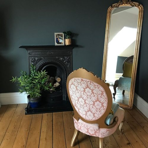 Dark walls, exposed wooden floorboards, gold gild freestanding mirror and vintage armchair victorian style on www.lovetohome.co.uk - photo credit with permission from Claire via @houseofharwoodandrose on Instagram