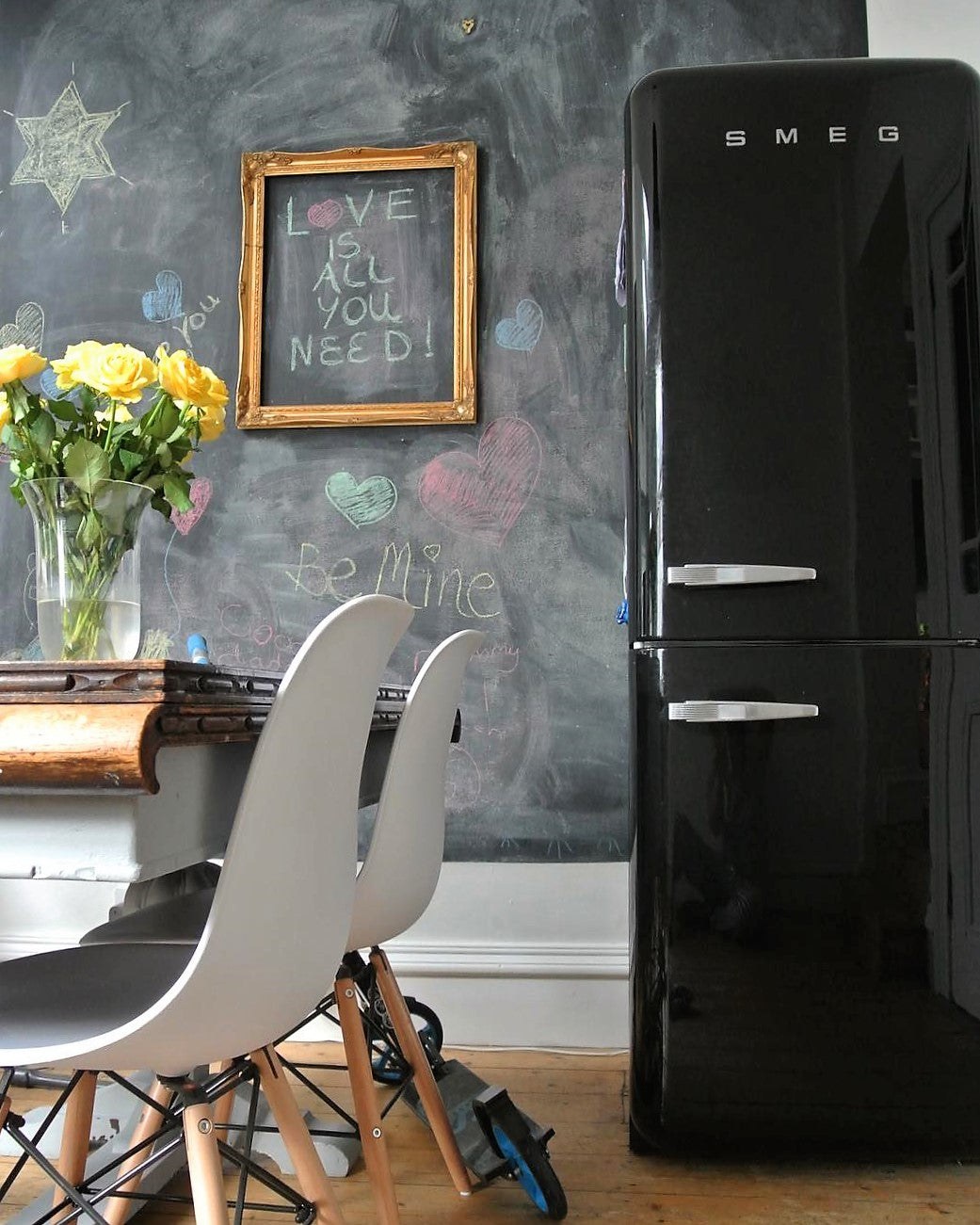 Kitchen black smeg fridge with chalkboard wall on www.lovetohome.co.uk - photo credit with permission from Claire via @houseofharwoodandrose on Instagram