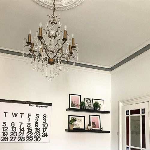 White living room grey trim chandelier calendar on www.lovetohome.co.uk - photo credit with permission from Claire via @houseofharwoodandrose on Instagram