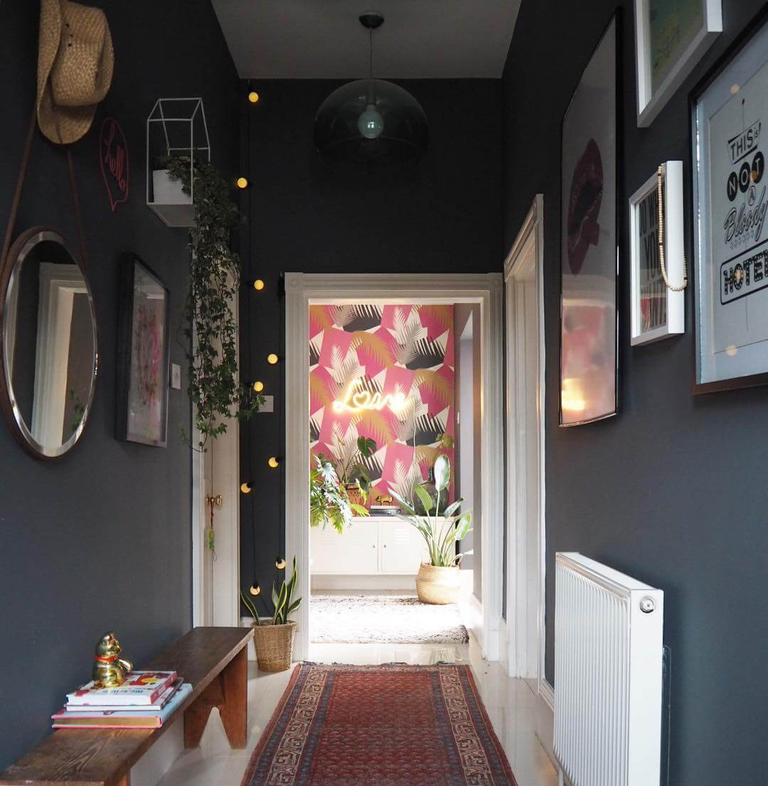 This entrance hallway is dark, glamorous and eclectic. Find out more on www.lovetohome.co.uk Photo credit @_lisa_dawson_