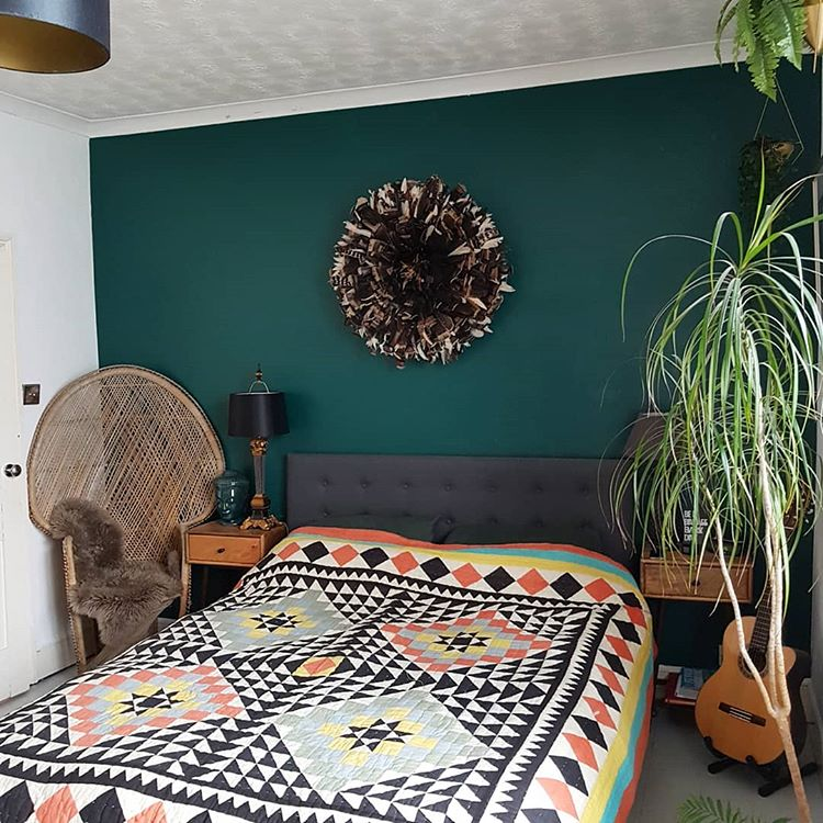 Helen's green bedroom - boho style, dark walls and textures. Photo credit @thenewsaintly via Instagram