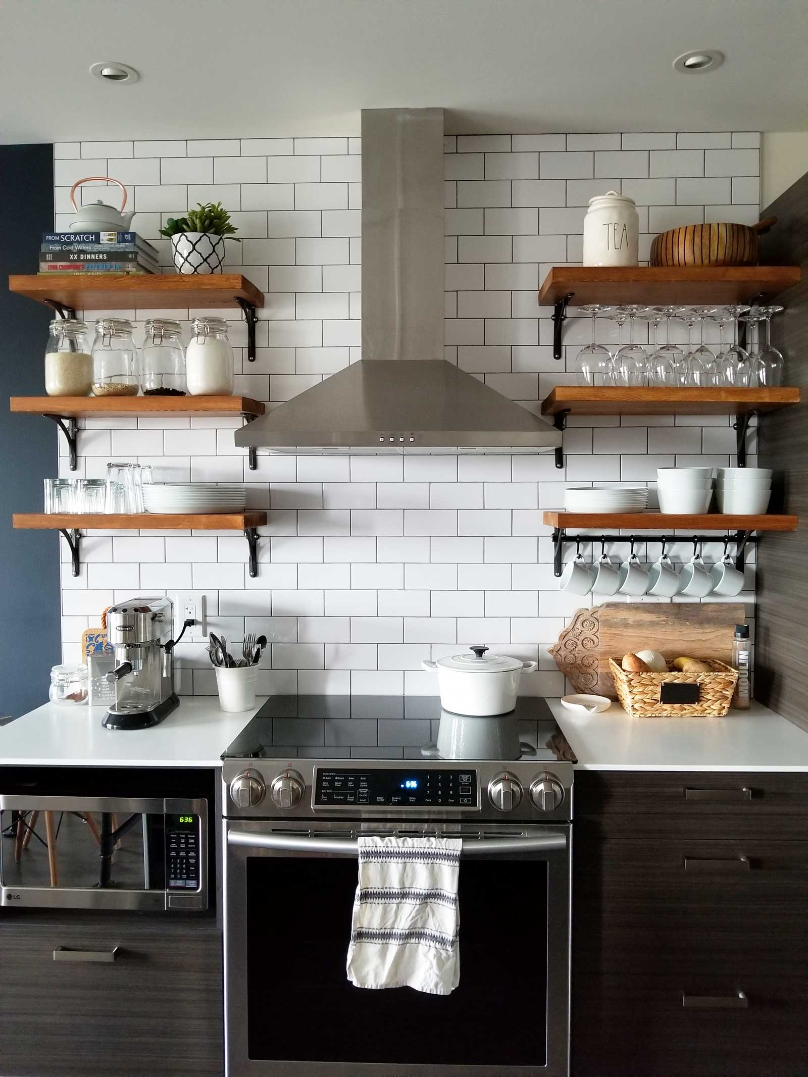 Loving the open shelving in this modern/industrial kitchen. It's a small space that looks beautiful. See the full home tour on www.lovetohome.co.uk