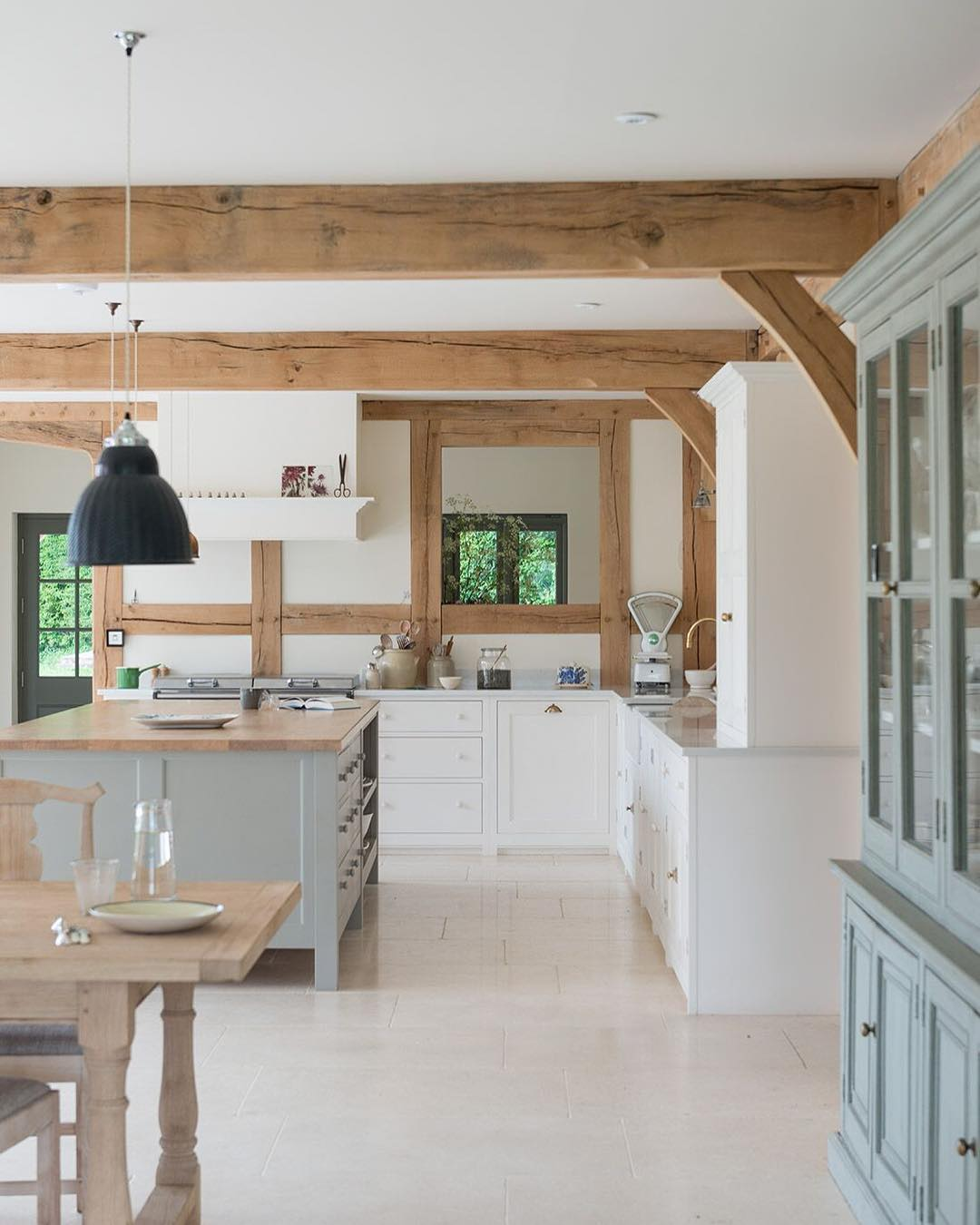 We love this British country kitchen - find out how to get the look (whether you live in the British countryside or not) on www.lovetohome.co.uk. Photo credit: @merryminvera and @border_oak via Instagram https://www.borderoak.com/