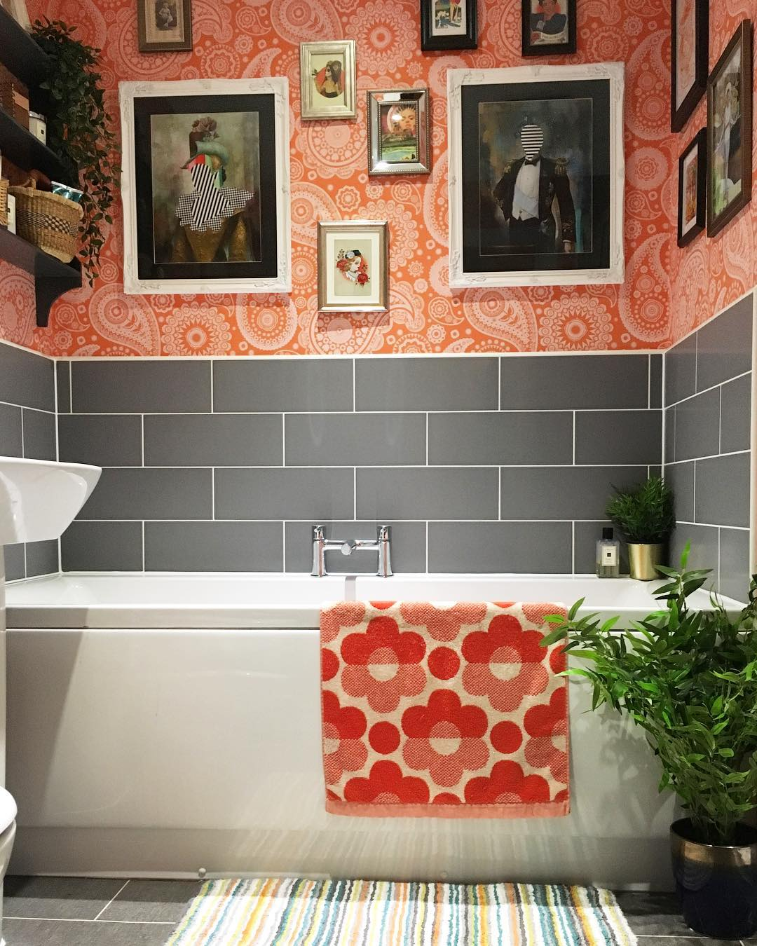 Colorful ensuite in grey tile and orange wallpaper. This is not your average magnolia new build. www.lovetohome.co.uk Photo credit: @projecthomedesign via Instagram