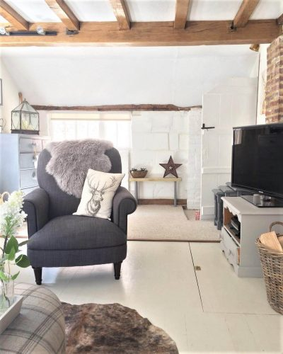 Living room armchair: would you renovate a listed property? Amanda did. Find out how she got in here on www.lovetohome.co.uk - Photo credit: with permission from @theoldforgecottage