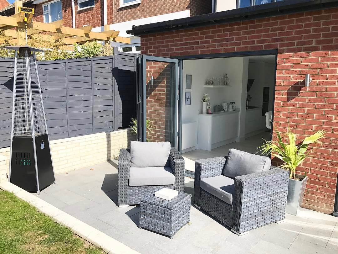 Fancy hanging out in this contemporary modern garden with bifolding doors that lead on to a scandinavian inspired kitchen?