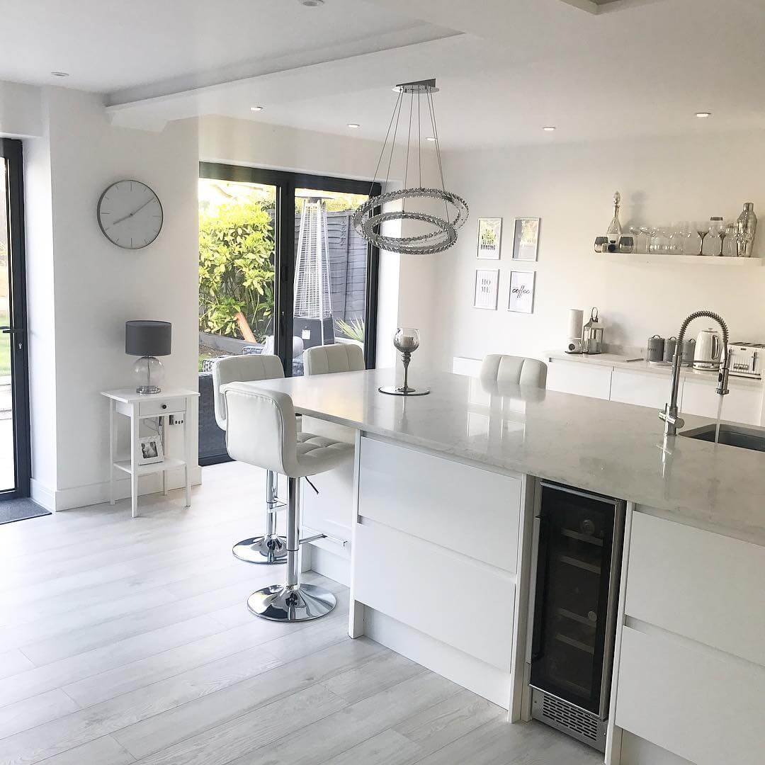 Take a tour around this Scandinavian inspired white modern contemporary open plan kitchen living room with bi folding doors.