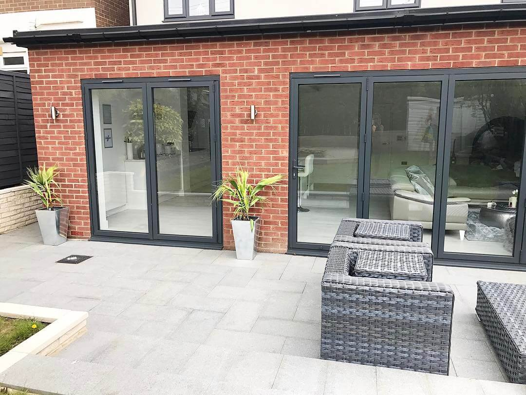 A stylish and contemporary garden design that joins onto a modern kitchen extension.