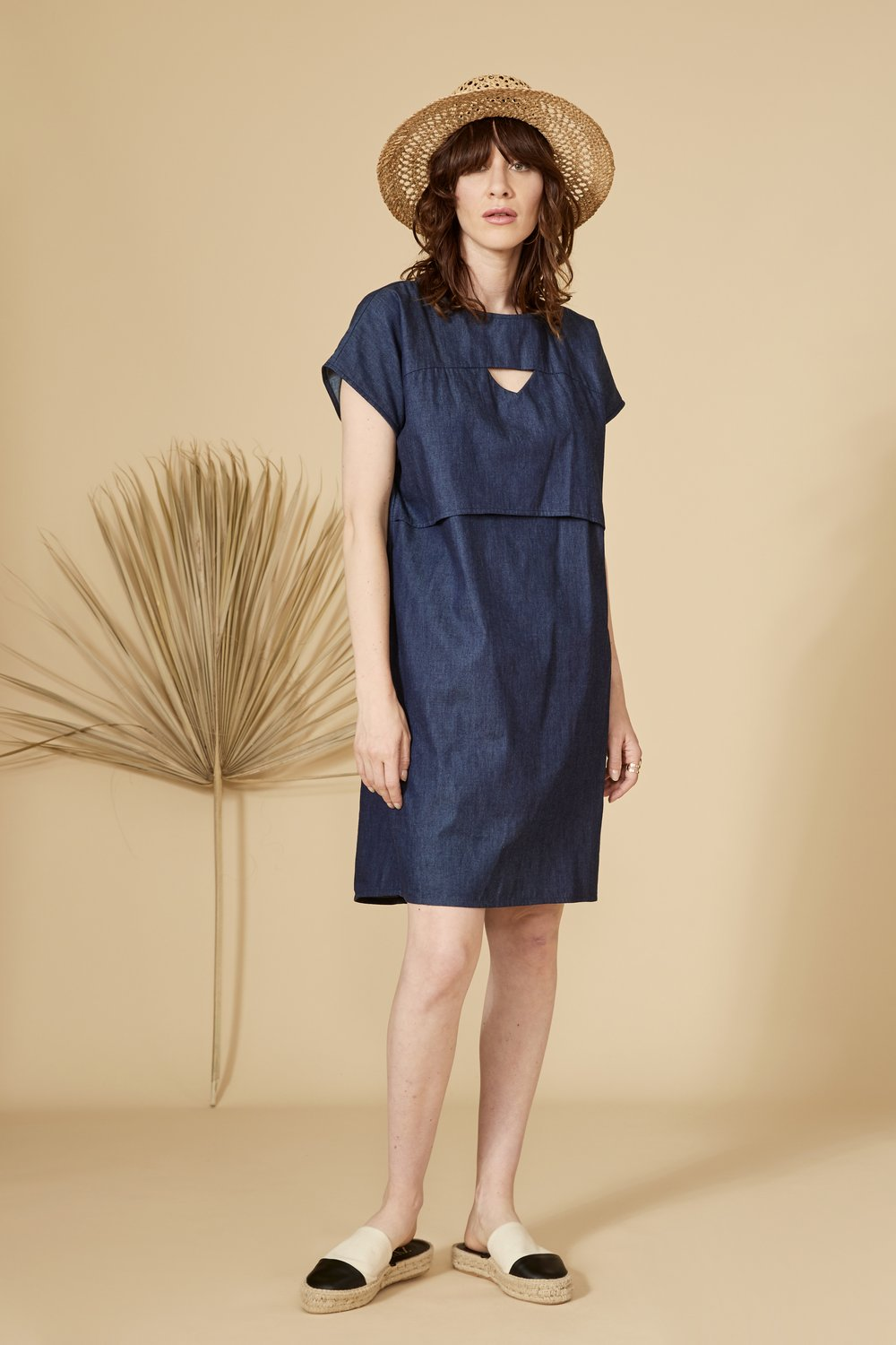 Denim cut-out dress with short sleeve, round collar and mid-thigh length. 70% viscose, 30% linen. Hand wash in cold water, air dry flat. Designed and Made in Montréal.