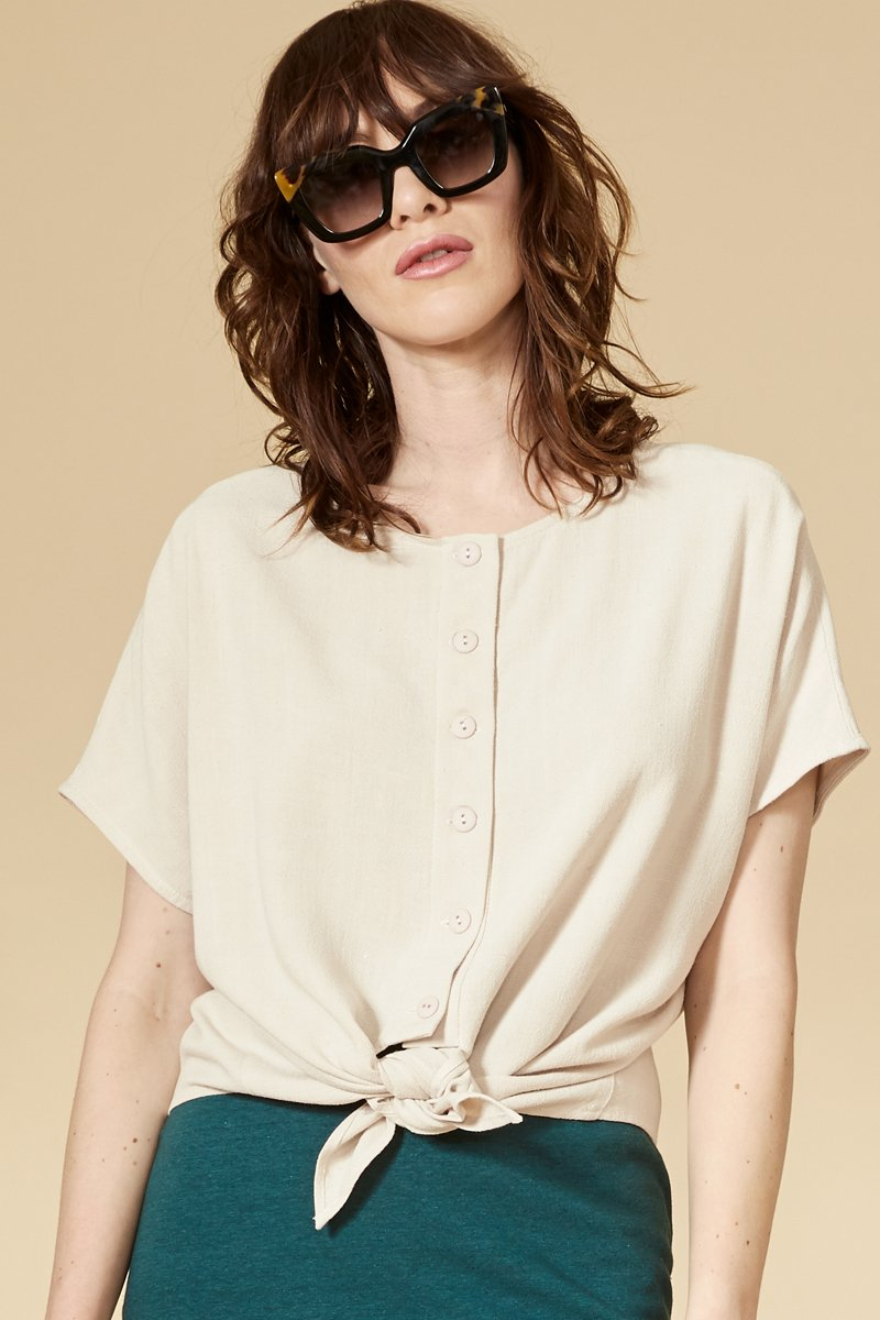 Sable reversible top with short sleeves. The buttoned side can be worn in front and behind. Round neckline.  70% viscose, 30% linen. Hand wash in cold water, air dry flat. Designed and Made in Montréal.