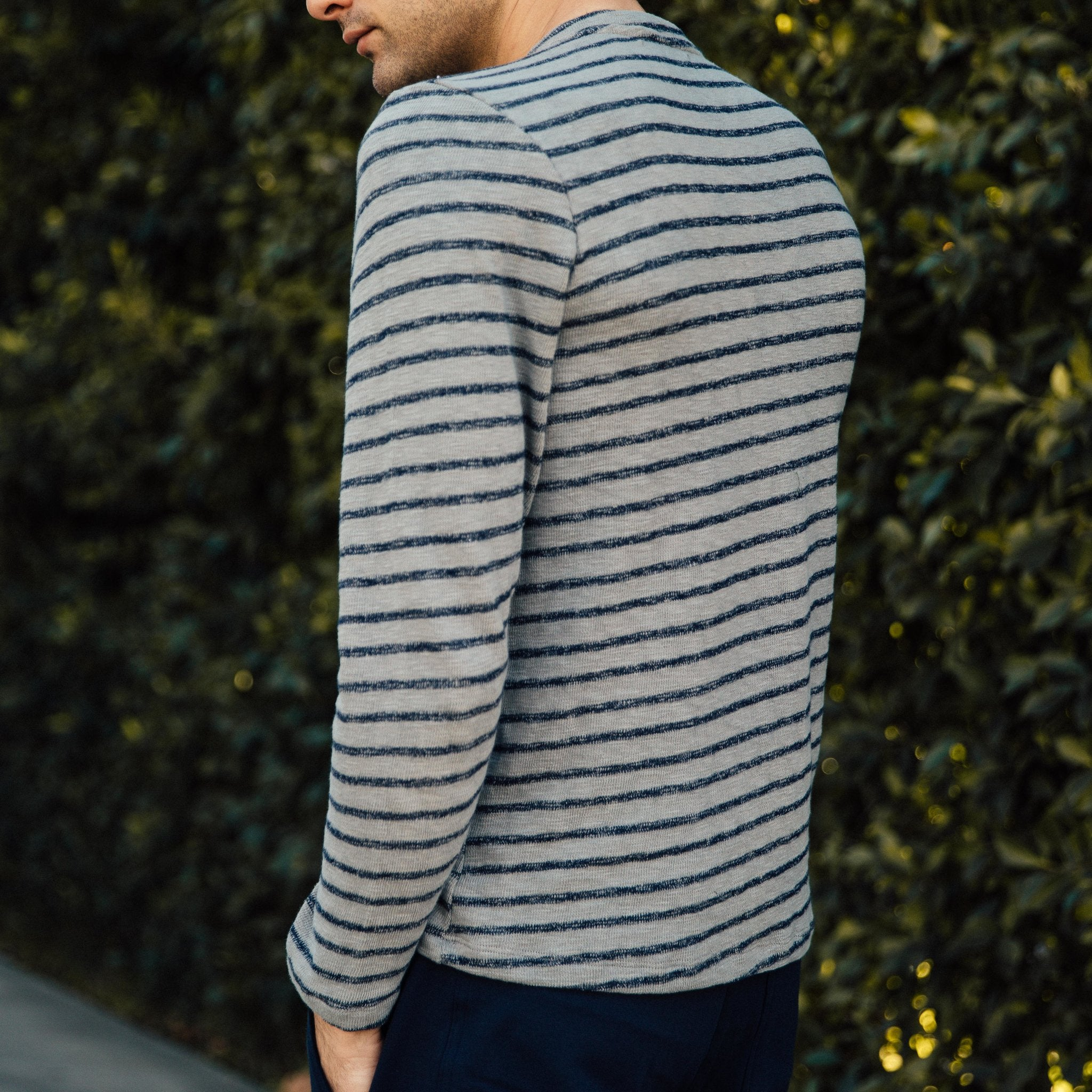 This grey Mitchell Evan wardrobe staple, crafted using a thread combination that gets softer with wear maintains its comfortable shape. Design centric yet playful, think of this striped sweater as ideal for multiple seasons. From cool summer evenings to layered during colder winter months, its versatility makes for a smart aesthetic slow-fashion choice. 88% Cotton, 10% Poly, 2% Spandex. Hand or machine wash cold, lay flat to dry. Made in America, 100% in Los Angeles.