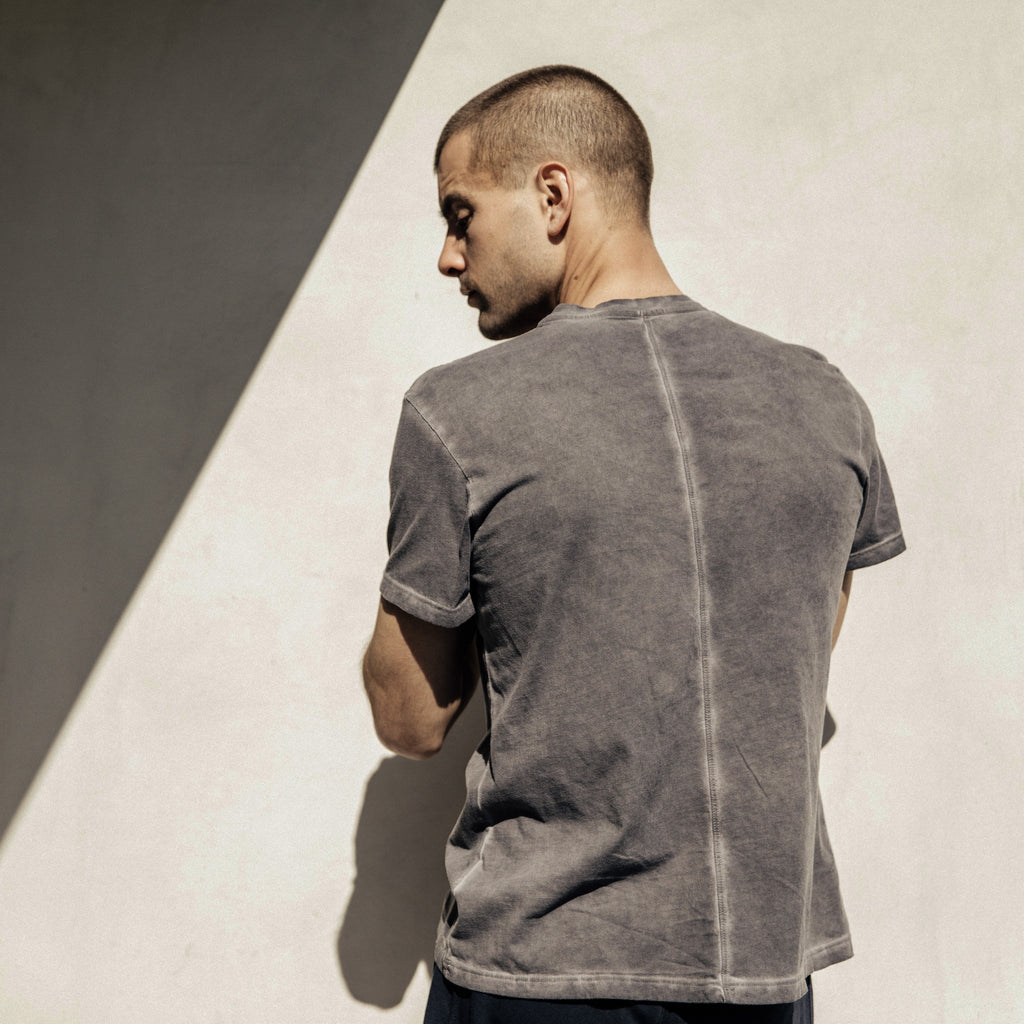 Iconic, well-loved, perfectly dyed tee in charcoal. The Taz T-shirt by Mitchell Evan features elevated construction details that lend a tailored look to an everyday essential. With a slim fit, soft to the touch cotton, this tee is a must-have basic that is not 'so basic'. 100% Cotton. Machine Washable Made in America, 100% in Los Angeles.