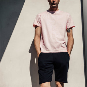 Iconic, well-loved, perfectly dyed tee in pink. The Taz T-shirt by Mitchell Evan features elevated construction details that lend a tailored look to an everyday essential. With a slim fit, soft to the touch cotton, this tee is a must-have basic that is not 'so basic'. 100% Cotton. Machine Washable Made in America, 100% in Los Angeles.