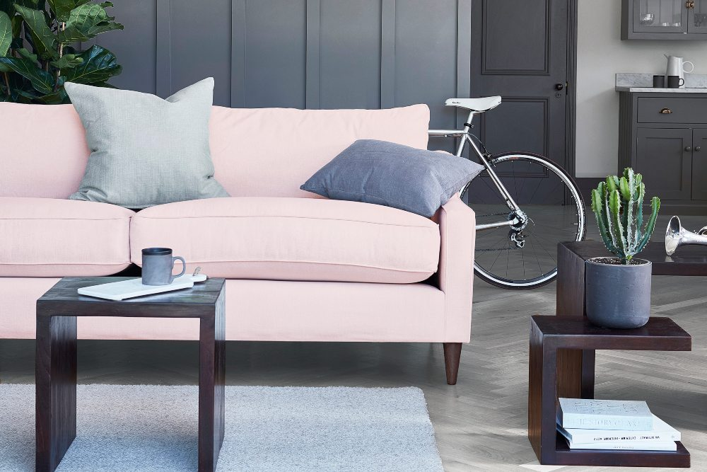 Create accents with colour on a neutral canvas pastel pink sofa
