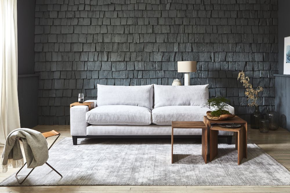 Industrial interiors grey new york sofa with decorative tiled feature wall