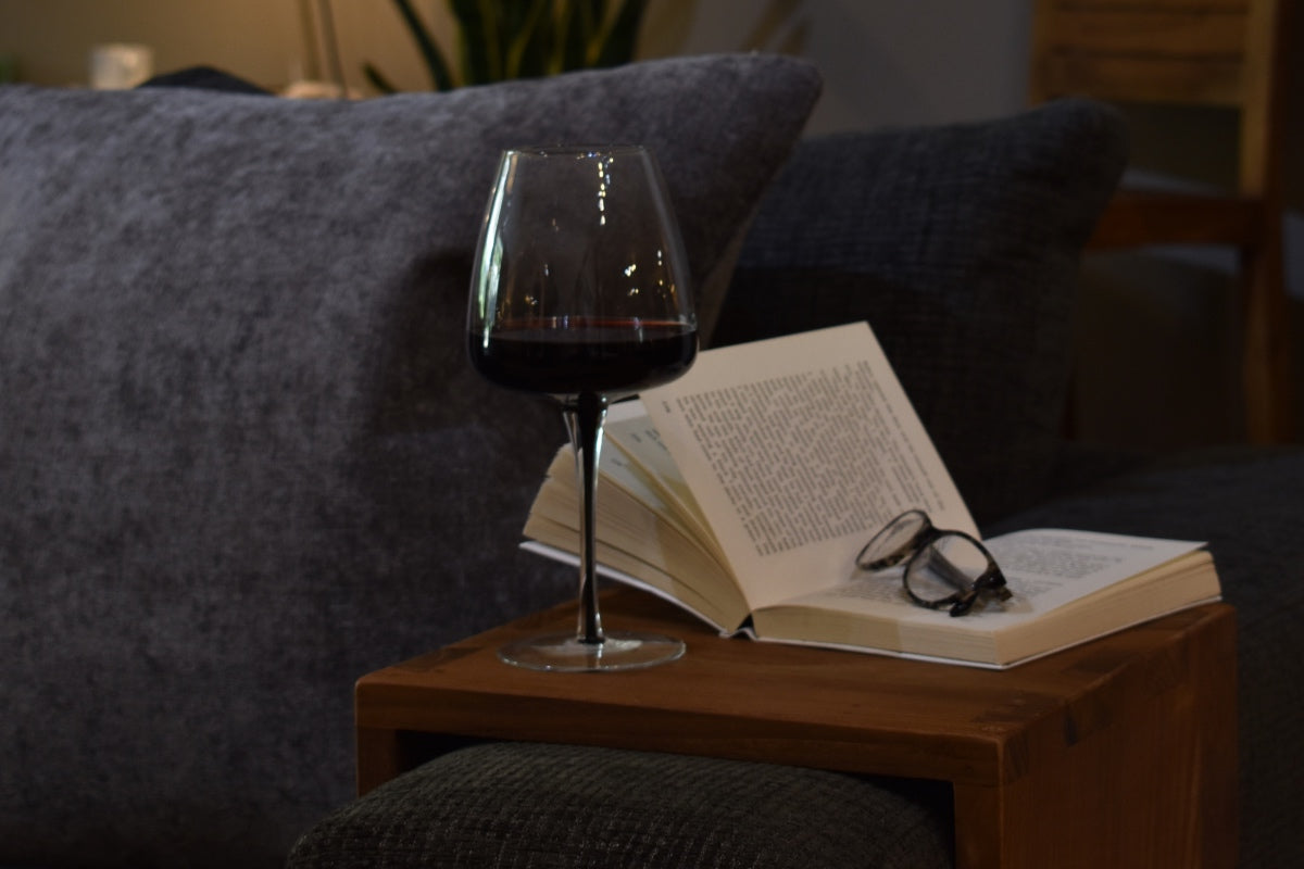 Mother's Day gifts book on teak armrest with glass of red wine