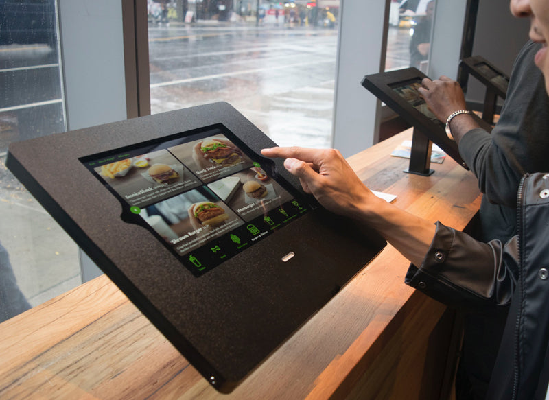 The Shake Shack kiosk, which includes a card reader and home button access.
