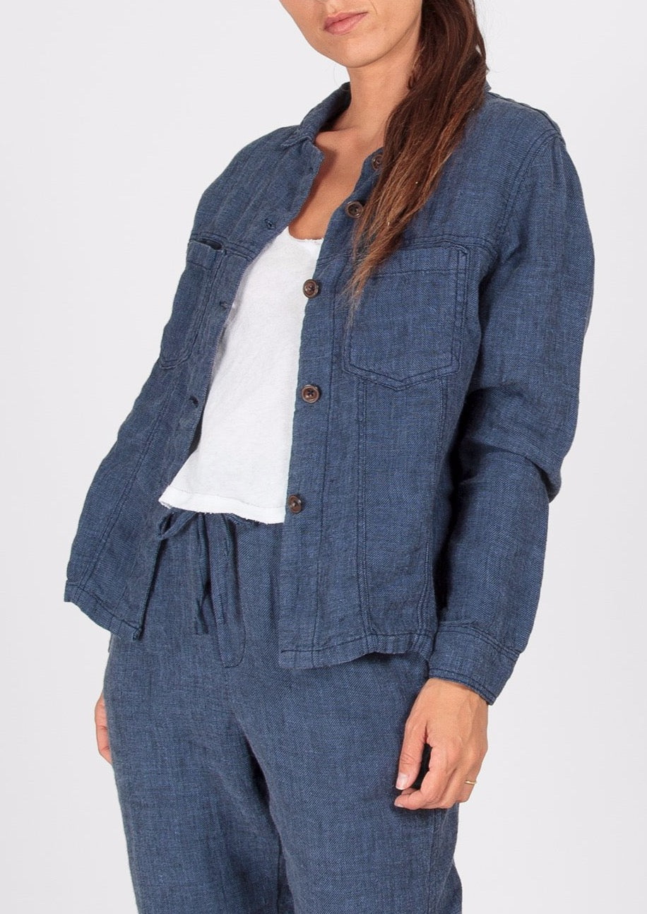 Combining the timeless look of denim, with a gentle softness and ease of linen.  A relaxed mid length jacket in dark denim. Cosy and soft, you'll feel at ease throwing this on over winter base layers and lounge pants, or over relaxed summer dresses. The perfect blend between casual and smart. Timeless Ridley style.  100% Linen  Made in Indonesia