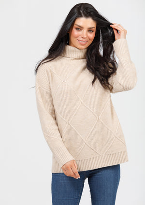 Trevi Knit - Ecru, by Shanty  This easy-wearing roll neck knit is a stylish alternative to your favourite slouchy jumper. Made from a divine cable knit, the Trevi Knit is super soft, comfortable and gives you a flattering silhouette.  Details:  • Roll neck • Long sleeves • Cable knit design • Regular fit