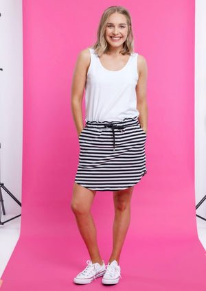 Home-Lee Mini Skirt - Black & White Stripe  This super cute Mini Skirt is great for all year round!  Made from soft Cotton/Elastane, it has great stretch and recovery, and washes & wears so well. Featuring a scooped hem at the front and back, pockets, an elastic waist and drawstring for the perfect fit.  Fit:  Model Gracie wears a size 8 and is 167cm tall