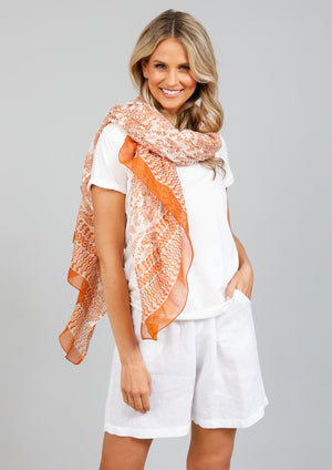 Paradise Sarong/Scarf - Sunset Tonga Print  Offered in a colourful array of eclectic prints, complete your holiday look with the Paradise Sarong. Tie it at the waist for pool-side lounging or change things up and wear it as a scarf! Versatility is key making this one an essential accessory for your next summer getaway!