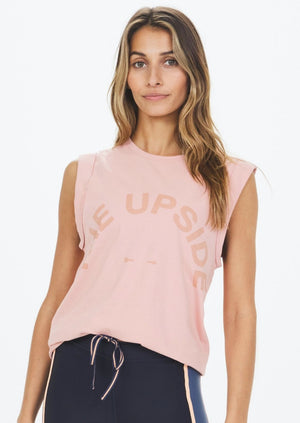 Muscle Tank - Peach Blush, by The Upside  This Muscle Tank is one sweet staple...  - Sleeveless tank in peach blush hue.  - Low-cut armholes for old-school edge.  - Rolled bind detail at sleeve for tomboy cool.  - Tonal Horseshoe logo across chest.  - Pure cotton for everyday luxe.  Fabric & Care:  100% COTTON cold machine wash with similar colours wash inside out do not soak, bleach or wring line dry in shade do not tumble dry do not use fabric softener no iron do not dry clean