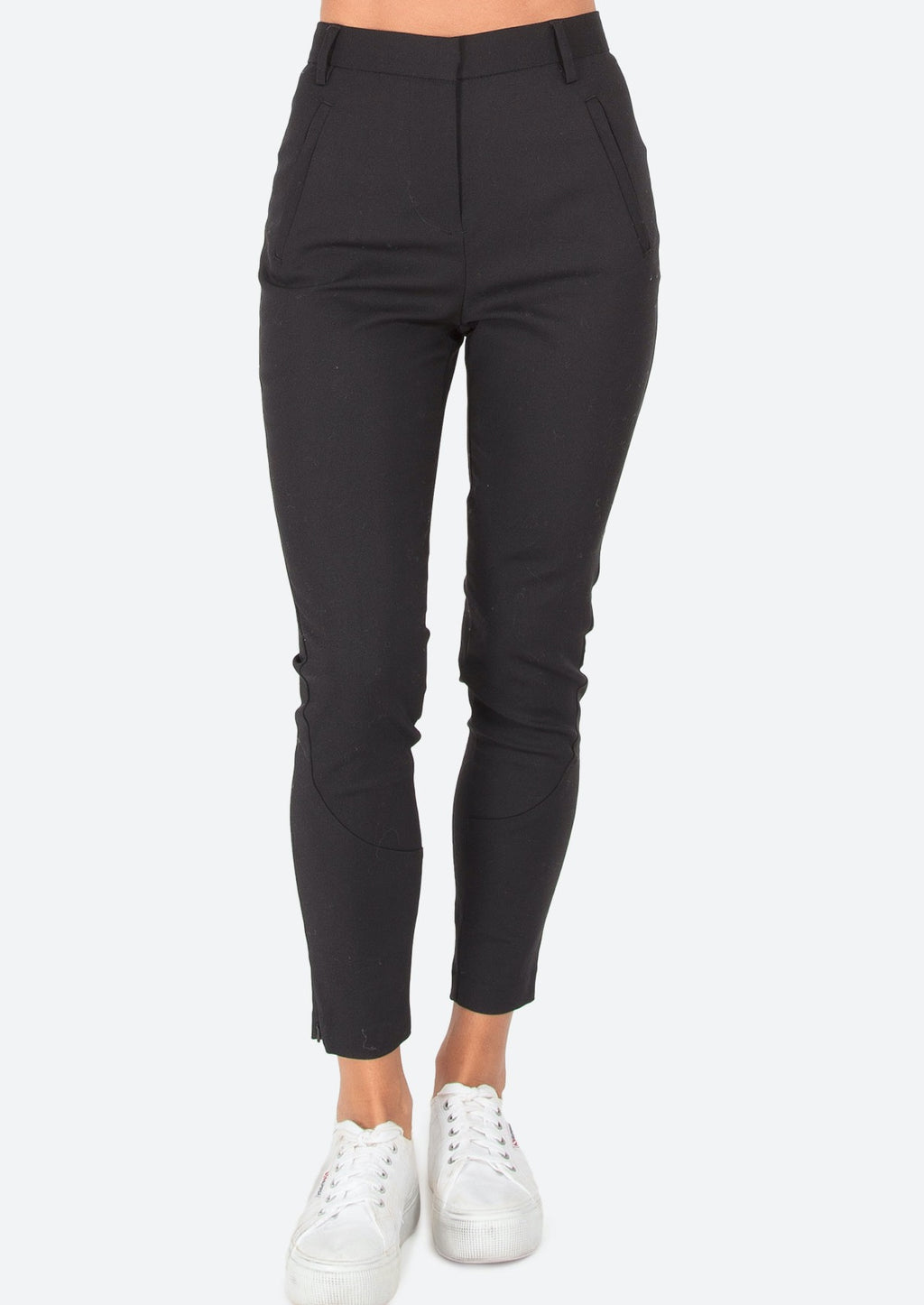 Nest Pants - Black, by Ridley  A super comfortable slight stretch pant that can be dressed up or down.  We love the streamlined features and 7/8th length for the perfect fit and maximum versatility.  Features:  7/8th leg length  Side zips at ankle for a slimline fit  Stretch for comfort and shape  Side pockets with zips for a streamlined look  Hook and bar closure at waist