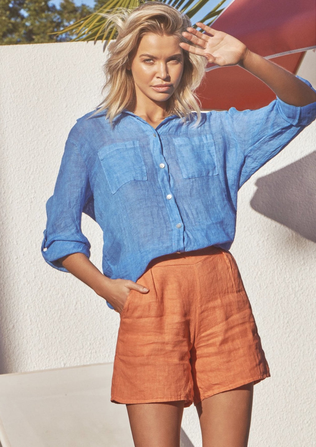 Hello Summer Short - Orange, by Ridley  Our new Linen shorts from Ridley the label will be on high rotation this summer. With a flat front waist band, elasticated back, and side pockets, these shorts are casual cool at its best.  Crafted from linen, the Hello Summer Short are a timeless staple that you'll pull out year after year.  Also available in White and Ink Pull On Style Pockets FABRICATION | 100% Linen - Cold Machine Wash