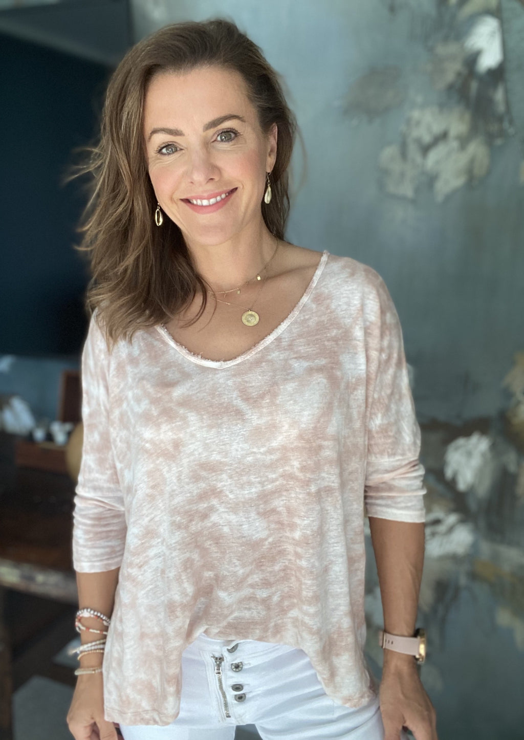 It's Time Top - Dusty, by Ridley  A relaxed long sleeve linen tie die top to through on with denims or white linen pants,  We love it teamed with our White Ocean Sounds Pant, and more casual with our Italian Star White or Musk Button Jeans. But an fave light denims will do!  100% linen jersey  Raw edge V-neck  3/4 sleeves  Relaxed fit  Made in Italy