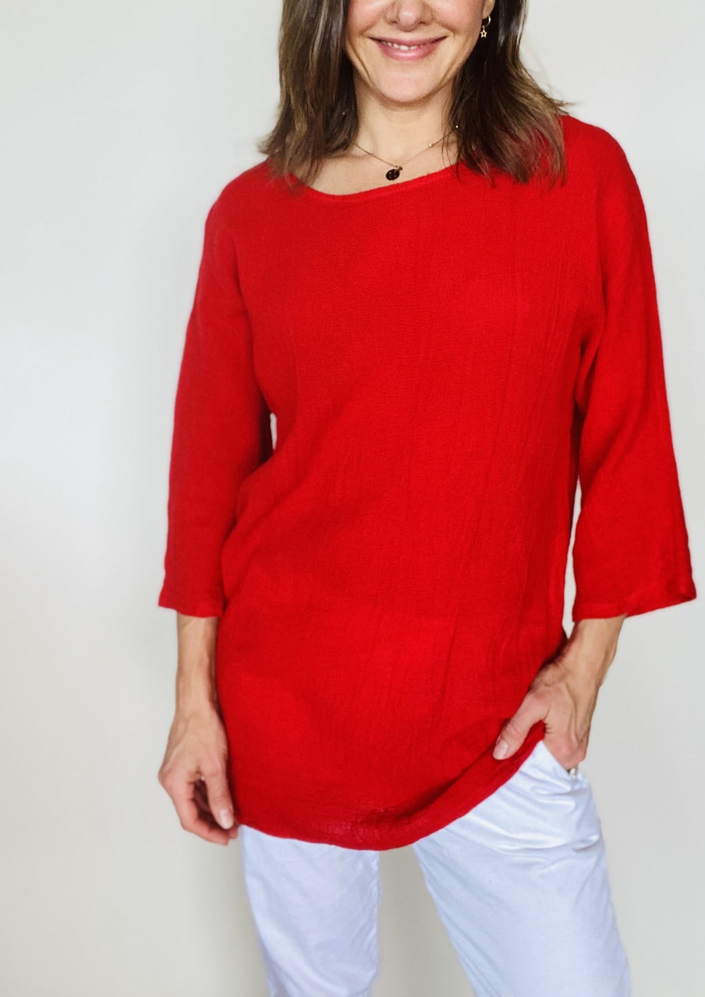 This casual long box top features Ridley's signature weave, scoop neck and 3/4 sleeves.  A warm pop of colour, this top looks great with fitted pants or jeans, and will help boost you mood on dreary days.  50/50 Linen/Cotton  Made in Italy