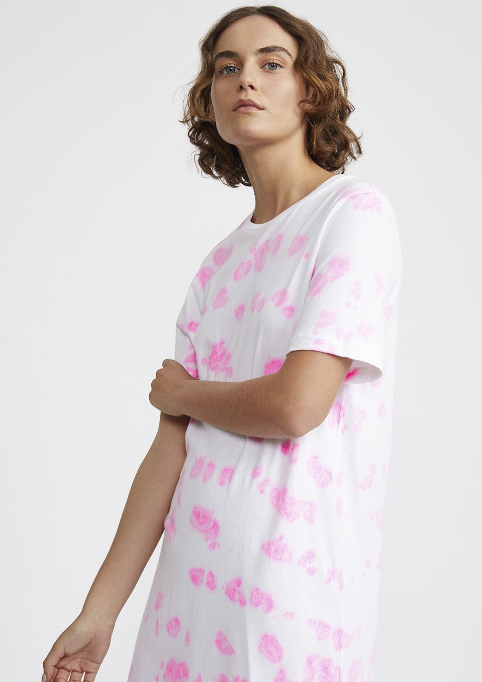The Ruby Tee Dress in neon pink tie dye is crafted from 100% premium organic cotton jersey and features a rounded neckline, classic straight hem and regular t-shirt fit.