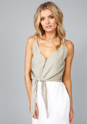 Riviera Tie Singlet - Tea  Brunch, beach or BBQ, this gorgeous Shanty Corp. tie singlet will be just at home in any summer setting.  The wooden buttons give it a particularly relaxed, but still stylish feel.  Pair down with denims, or elevate your look with any of our gorgeous linen shorts, pants or skirts, wedges and our wide Elasticated Belts.  Complete your look with our Monza Jacket.  Features:  V-neck and back Perfect length to waist without being crop Thin straps Wooden buttons Front tie