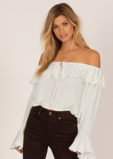 The Bella Babe Knit Top is an off the shoulder top featuring a keyhole, ruffle details and bell sleeves.