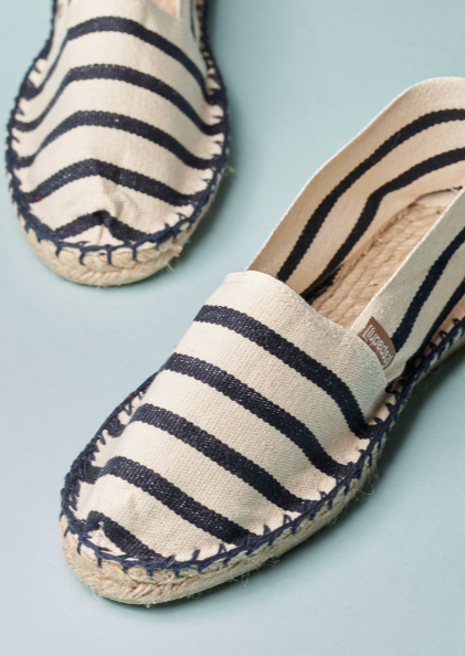 The original Espadrij flat shoes with a solid rubber sole with Beige and Navy Stripes.