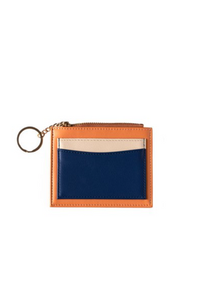 A cute and convenient accessory to keep your cards, keys and coins all in the one place.  Vegan leather with gold look hardware.  Toffee/Beige/Navy