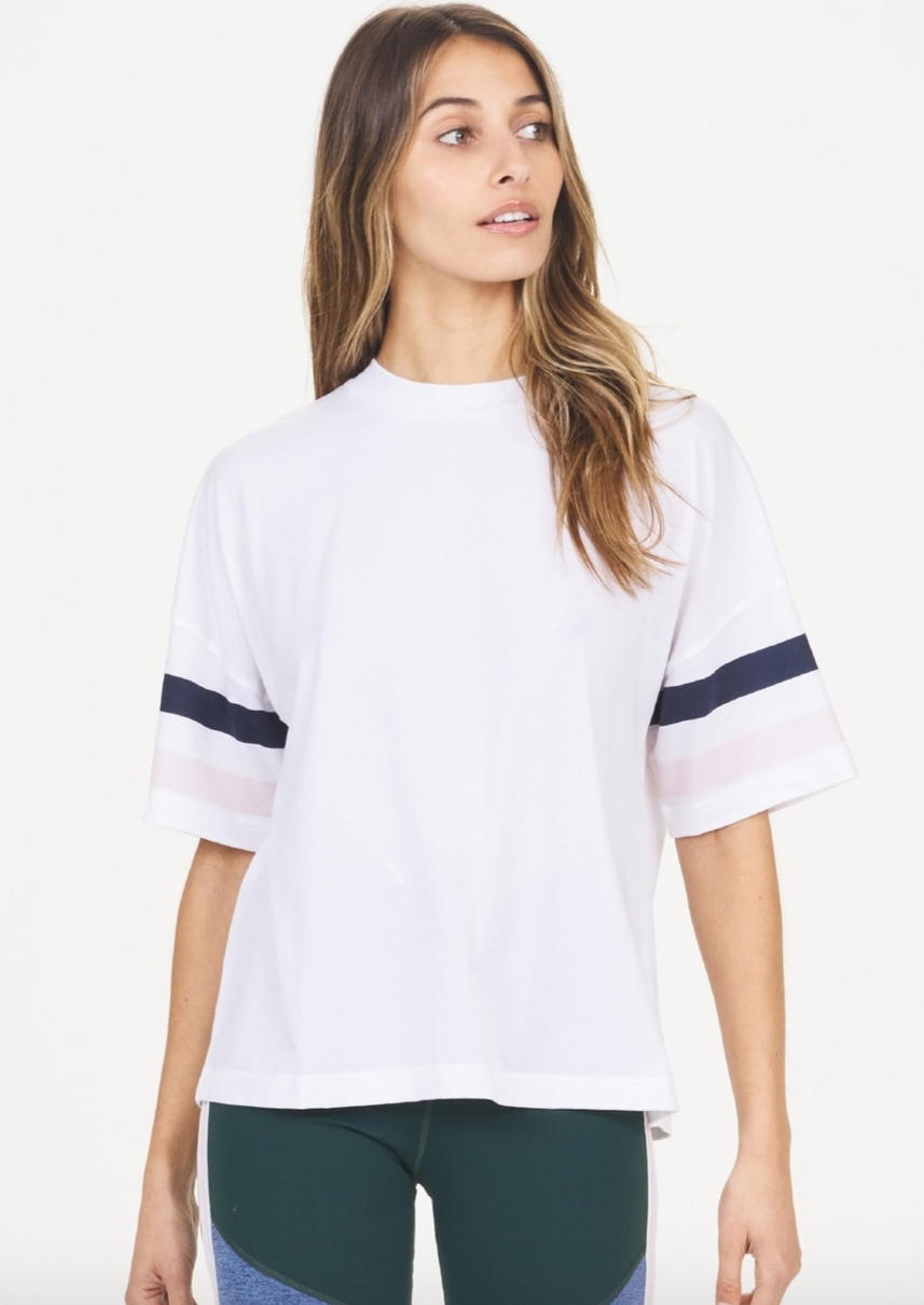 Carla Tee - White, by The Upside  Just like your boyfriend's.. but better. Say hi to our Carla Tee..  Oversized performance tee in fresh white. Elbow-length sleeves with navy and powder pink stripe detail. Lightweight, quick-drying and breathable cotton-blend fabric. Slight stretch to keep its shape Fabric and Fit:  Dri-release cotton/elastane blend  Model is 170cm tall and wears an AU XS which is a UK 8, US 4 and EU 34