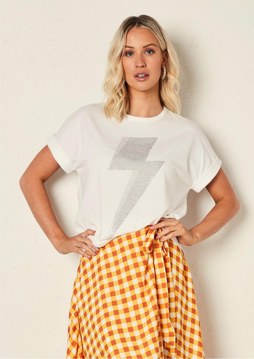 The Relaxed Tee - White with Bolt, by The Others  A beautifully soft, relaxed fit tee that pairs beautifully with our Sunray skirt, or or your favourite denims.  Details:  Crew Neck  100% Cotton